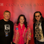 Lisa Kirkwood with Alex Lifeson and Geddy Lee of Rush
